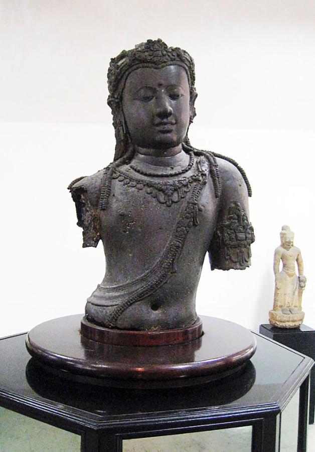 Srivijayan bronze torso statue of Boddhisattva Padmapani (Avalokiteshvara), eighth century CE (Chaiya, Surat Thani, Southern Thailand). The statue demonstrates the Central Java art influence. In 1905 Prince Damrong Rajanubhab removed the statue from Wat Wiang, Chaiya, Surat Thani to Bangkok National Museum, Thailand.