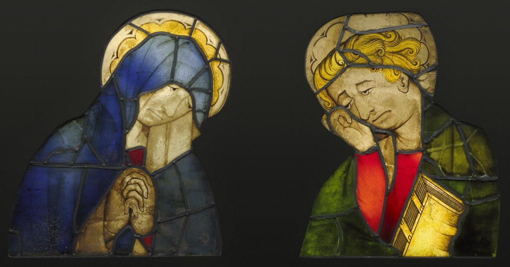 The Virgin and Saint John, from a Crucifixion, German, c. 1420, Dark brown vitreous paint, colored pot metal and clear glass, silver stain, H: 58.5 x W: 50 x D: 1 cm (23 1/16 x 19 11/16 x 3/8 in.) each (J. Paul Getty Museum, 2003.35)