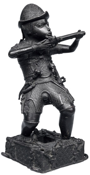 Brass figure of a Portuguese soldier holding a musket, 17th century C.E., Benin, Nigeria © Trustees of the British Museum