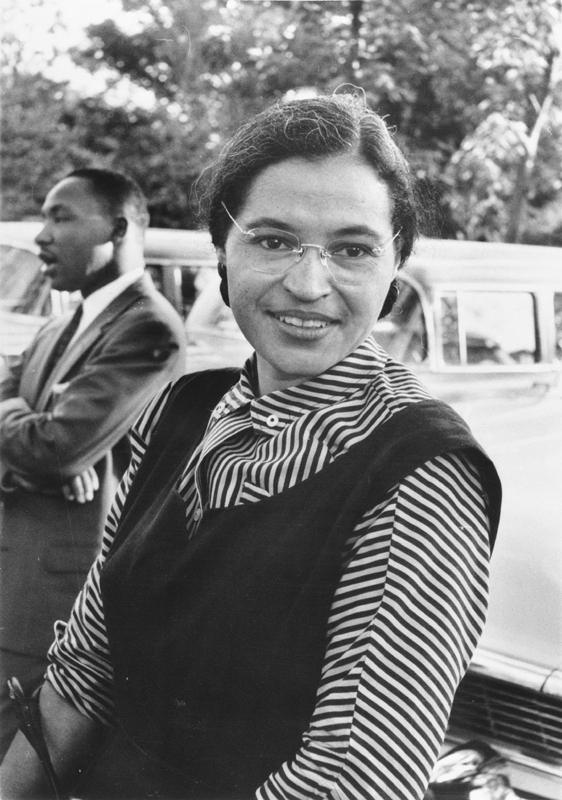 51ad7fc55 Black and white photograph of Rosa Parks. Martin Luther King Jr. can be seen