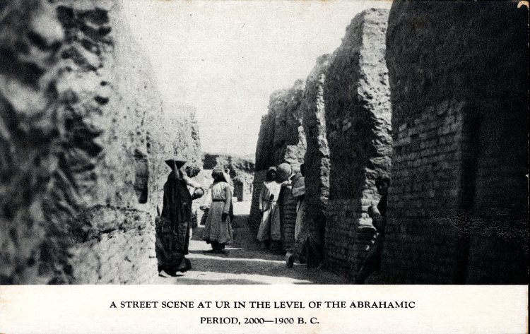 Postcard; printed; photograph showing archaeological excavations at Ur, with Arab workmen standing for scale in the excavated street of an early second millennium BC residential quarter. © The Trustees of the British Museum