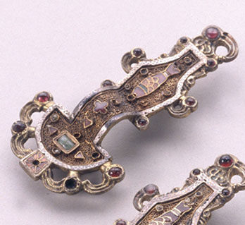 Merovingian (Frankish) Looped Fibulae, mid-6th century, silver gilt worked in filigree with inlaid garnet and other stones (Musée des Antiquities Nationales, Saint-Germain-en-Laye)