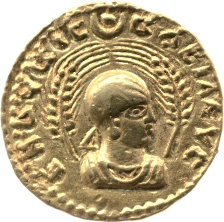 Gold coin, c. 270-300 C.E., gold, Aksumite, © Trustees of the British MuseumObverse showing head and shoulders bust of Endubis facing right, wearing headcloth with rays at forehead and triangular ribbon behind, framed by two wheat-stalks. Disc and crescent at top.