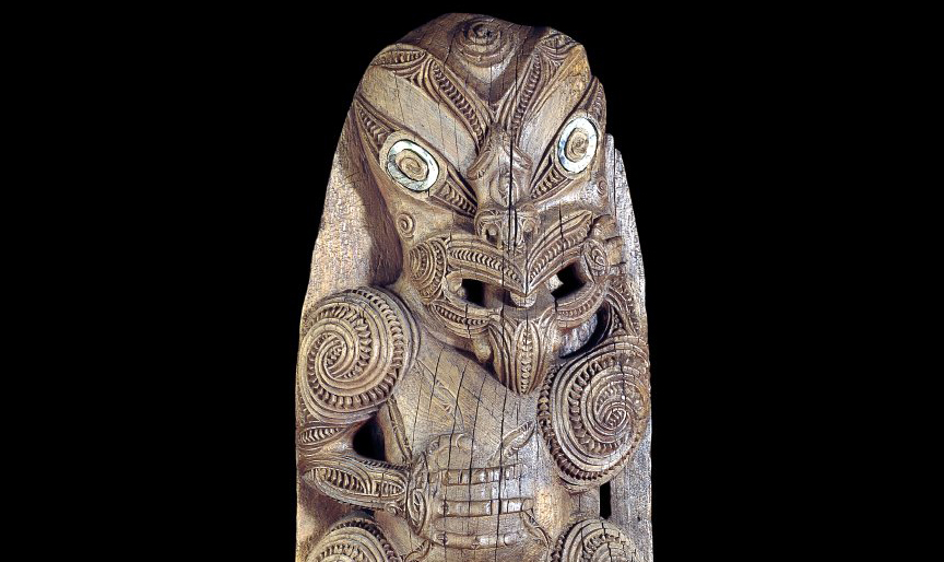 Upper figure (detail), House-board (amo), Maori, 1830-60 C.E., wood, haliotis shell, 152 x 43 x 15 cm, Poverty Bay district, New Zealand, Polynesia © Trustees of the British Museum