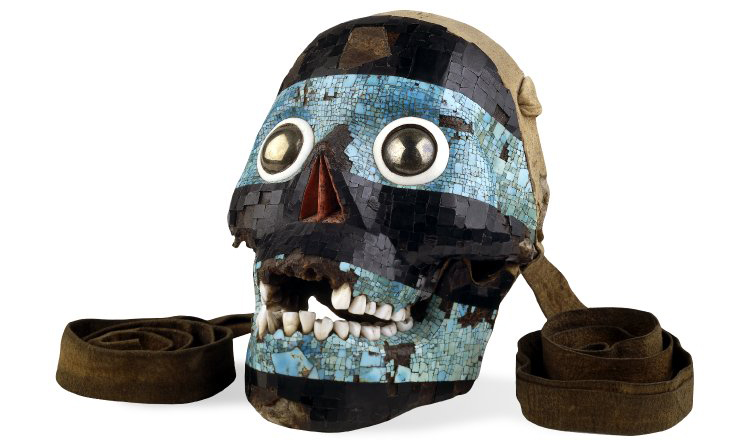 Mosaic skull of Tezcatlipoca, c. 15th-16th century C.E., Mixtec/Aztec, turquoise, pyrite, pine, lignite, human bone, deer skin, conch shell, agave, 19 x 13.9 x 12.2 © The Trustees of the British Museum