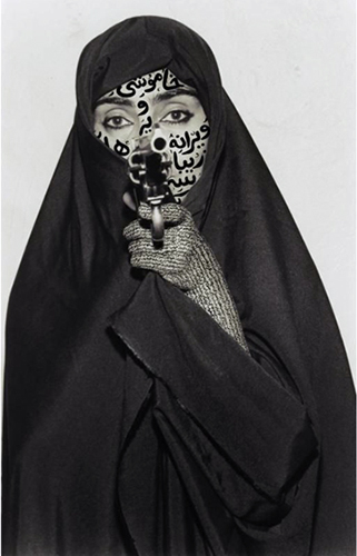 Shirin Neshat, Faceless, Women of Allah series, 1994, B&W RC print & ink, photo by Cynthia Preston ©Shirin Neshat, courtesy Barbara Gladstone Gallery, New York and Brussel)