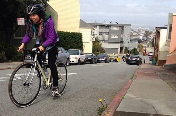 A photo of Brenda biking up the hills of San Francisco