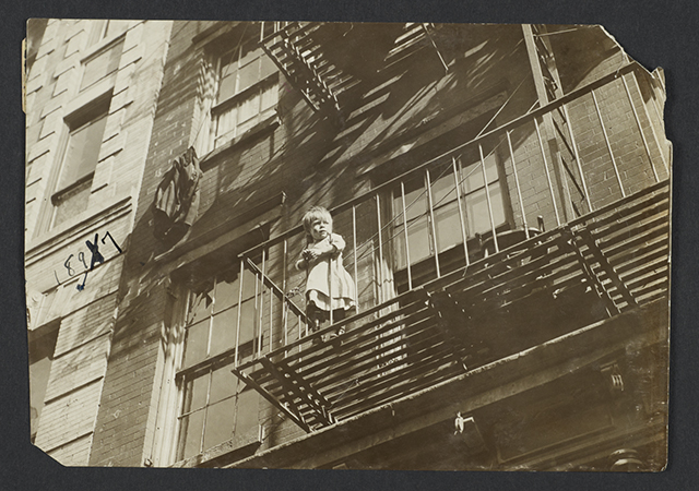Jessie Tarbox Beals, Child on Fire Escape (NYC), c. 1918, for the New York Association for Improving the Condition of the Poor (Columbia University Libraries)