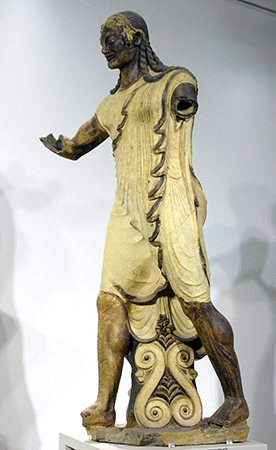 Apulu (Apollo of Veii), from the roof of the Portonaccio Temple, Veii, Italy, c. 510-500 B.C.E., painted terra-cotta, 5 feet 11inches high (Museo Nazionale di Villa Giulia, Rome)