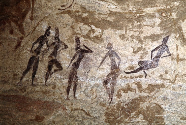 Painted rock art depicting five red figures, from Jabbaren, Ajjer Plateau, Djanet, Tassili, Algeria. 2013,2034.4248 © TARA/David Coulson
