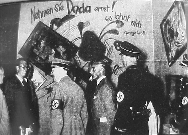 Adolf Hitler and Adolf Ziegler inspect the installation by Willrich and Hansen of the Degenerate Art Exhibition in Munich, 1937