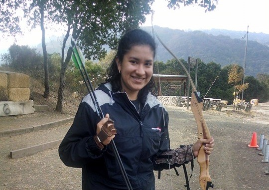 Photo of Amy with archery bow