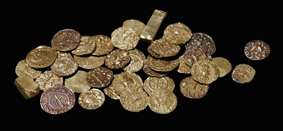 Gold coins and ingots from the ship burial at Sutton Hoo, early 7th century, Sutton Hoo, Suffolk, England, © Trustees of the British Museum.