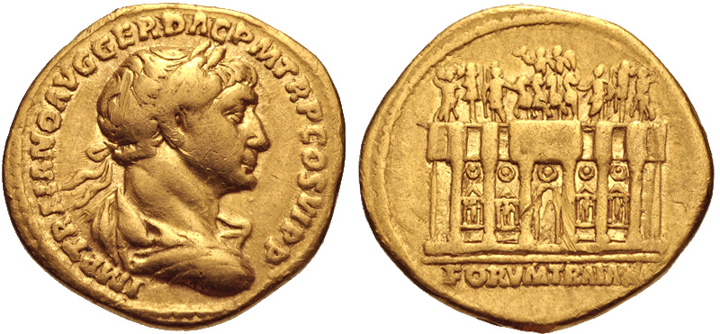 """Gold coin (aureus) struck at Rome c. 112-115 C.E. (19 mm, 7.13 g, 7h). The legend reads """"IMP TRAIANO AVG GER DAC P M TR P COS VI P P (""""To the emperor Trajan Augustus Germanicus Dacicus, Pontifex Maximus, [holder of] tribunician power, in his sixth consulship, father of his country"""". The coins depicts a laureate Trajan (draped, and cuirassed bust right) seen from behind on the observe side. On the reverse the Arcus Traiani of the Forum of Trajan is seen. This is presented a hexastyle building facade, crowned by a frontal chariot drawn by six horses. Three figures stand to the left and right, while four statues occupy niches in the arches below. The reverse legend reads """"FORVM TRAIAN[A]""""."""