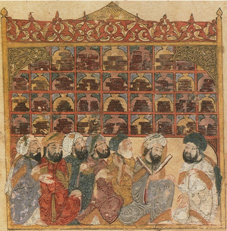 Artwork of scholars at an Abbasid library. Seven men sit in front of a bookshelf; one man is reading from an opened book.