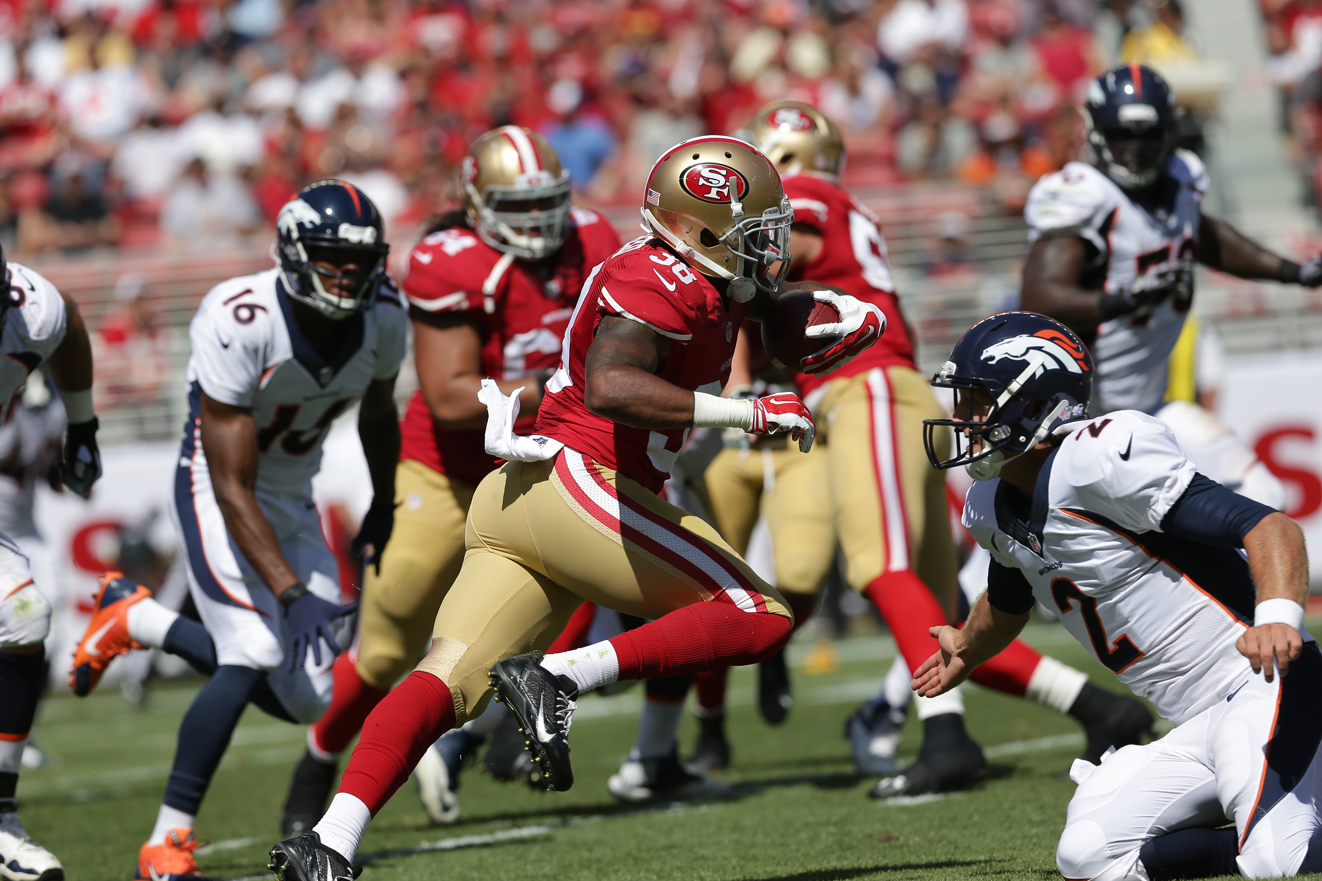 861e742d1419 A player in red and gold uniform running in middle of a game, where  opponents