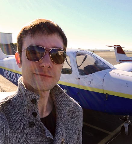 Photo of Tom in front of plane