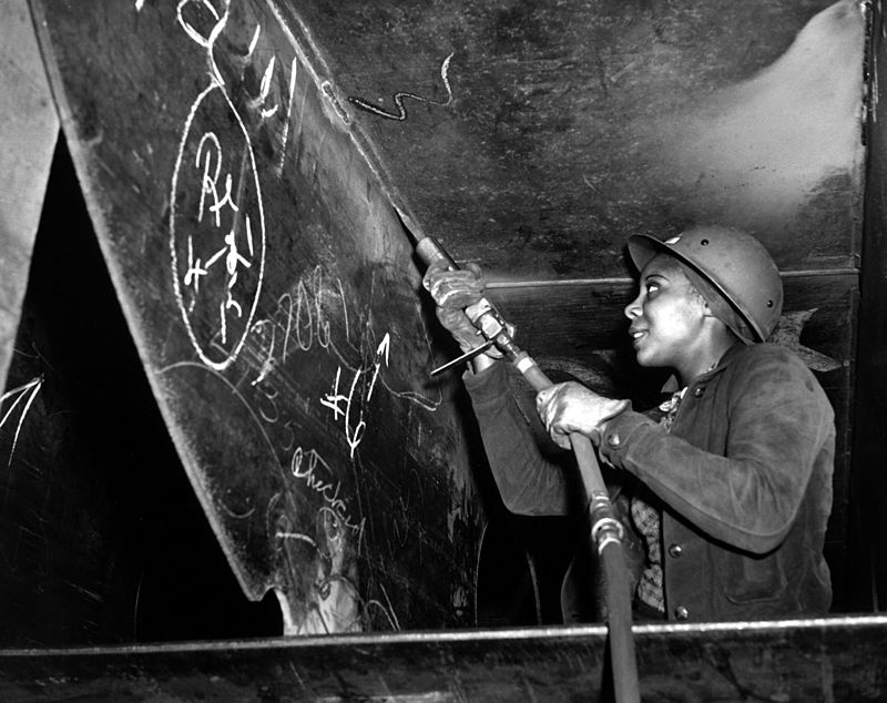 Photograph of an African American woman working on a battleship.