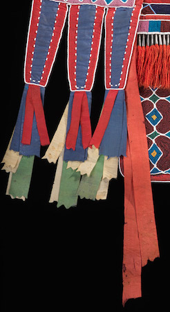 Silk ribbons (detail), Bandolier Bag, Lenape (Delaware tribe, based in Oklahoma), c. 1850 C.E., hide, cotton cloth, silk ribbon, glass beads, wool yarn, metal cones, 68 x 47 cm (National Museum of the American Indian, New York)