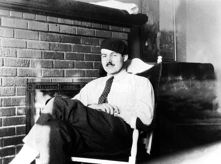 America In The S Jazz Age  Roaring S Article  Khan Academy Photograph Of Ernest Hemingway Sitting In Front Of A Fireplace Wearing A  Beret