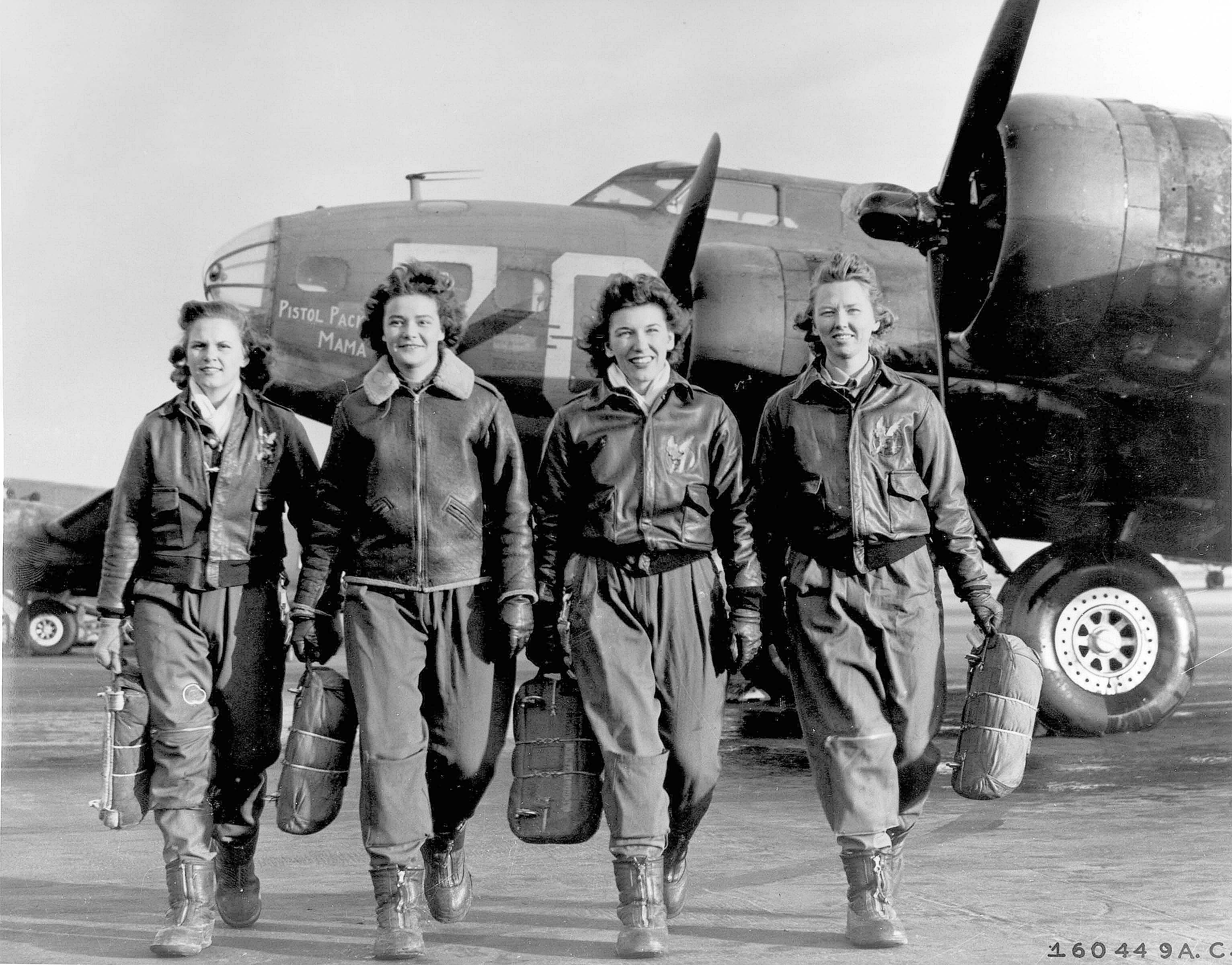 Photograph of four white women pilots from the Women's Airforce Service Pilots division.