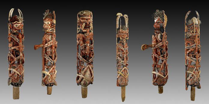 Malangan figures, 1882-83 C.E., wood, vegetable fiber, pigment and shell (turbo petholatus opercula), north coast of New Ireland, Papua New Guinea © Trustees of the British Museum