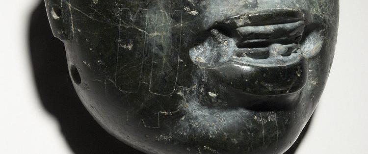 Olmec stone mask (detail with gylphs), c. 900-400 B.C.E. Olmec, greenstone, 13 x 11.3 x 5.7 cm © Trustees of the British Museum