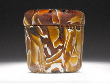 Lidded Container with Amber and White Marbling, Roman, A.D. 1–100 C.E. Roman, glass, 2 inches high x 2 1/4 inches in diameter