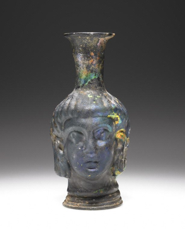 Mold-blown Head flask, Roman, 4th - 5th century C.E., glass (The J. Paul Getty Museum, Villa, 2004.44)