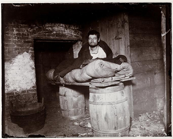 Jacob August Riis, A man atop a make-shift bed that consists of a plank across two barrels, c. 1890, 7 x 6 inches from How the Other Half Lives: Studies Among the Tenements of New York, Charles Scribner's Sons: New York, 1890