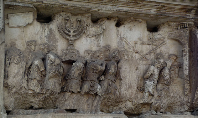 "Relief depicting a triumphal procession into Rome with loot from the temple, including the menorah, panel in the passageway, Arch of Titus, Via Sacra, Rome, c. 81 C.E., marble, 6'-7"" high"